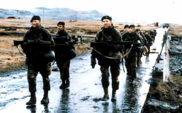 British soldiers march into Port Stanley on the Falkland Islands